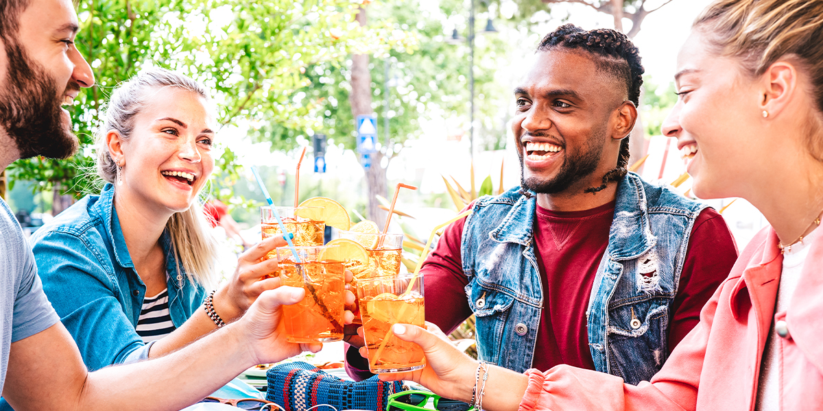 Image of people enjoying drinks on an outdoor patio