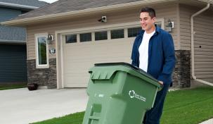 Image of young man taking his curbside collection out