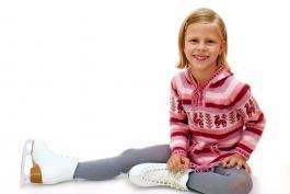 Photo of little girl wearing skates