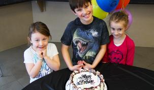 Photo of children with a birthday cake at the LRC
