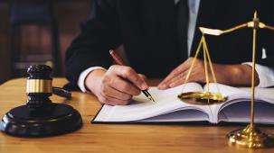 photo of someone writing bylaws