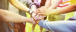Photo of group crossing hands