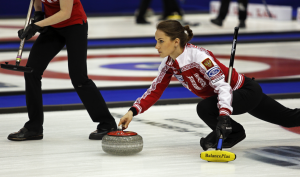 Photo of a woman curling