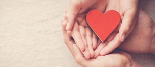 Image of hands holding a heart