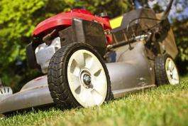 Image of lawn mower cutting grass