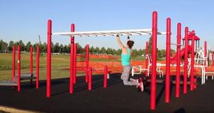 photo of person using outdoor fitness area in Lede Park