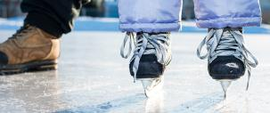 photo of skates on an outdoor ice surface