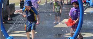 Photo of young boy enjoying the Alexandra Outdoor Spray Park