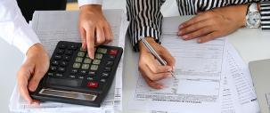 Photo of accountants working with calculator