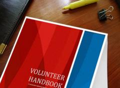 Photo of volunteer leduc handbook on desk