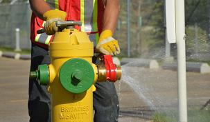 Photo of city employee working on fire hydrant