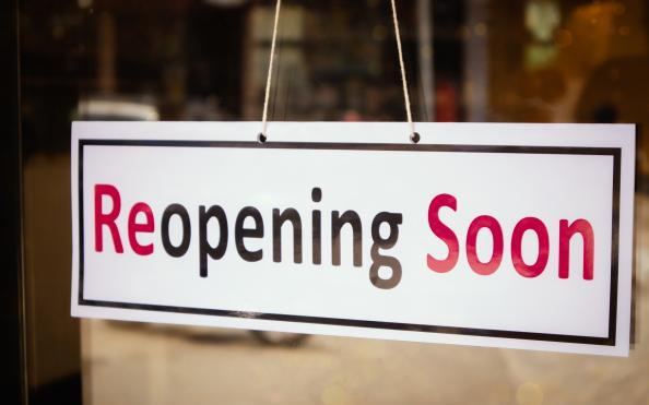 Photo of sign saying reopening soon