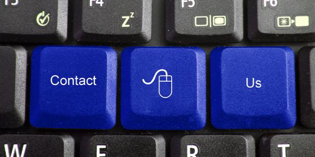 Image of a keyboard with keys saying contact us