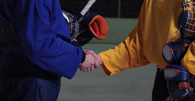 photo of hockey players shaking hands