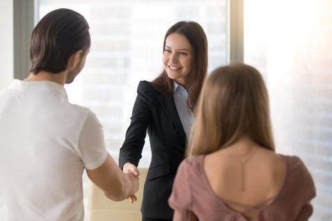 Example of a female candidate shaking hands