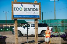 Eco Station employee in front of the facility