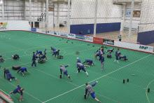 Photo of Oilers doing dry land training in the field house