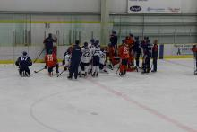 Photo of Oilers getting on ice direction from Coach McLellan