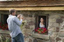 Image of couple posing for photos at the Stone Barn Garden in the Leduc Cultural Village