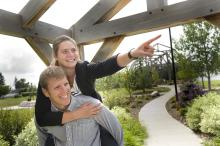 Image of couple walking through Stone Barn Garden in the Leduc Cultural Village