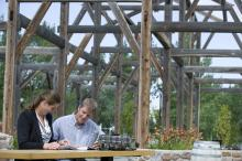 Image of couple sitting at Stone Barn Garden in the Leduc Cultural Village