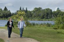 Couple walking along trail system next to Telford Lake