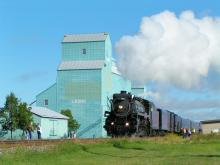 photo of steam engine passing the Leduc Grain Elevators