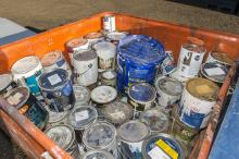Paint cans being collected during the annual toxic roundup at the Eco Station